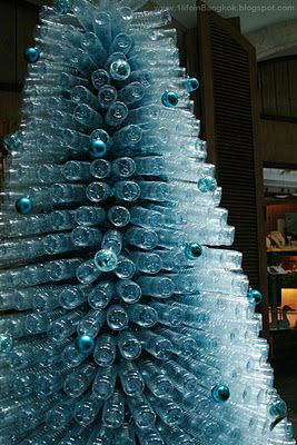 Xmas tree of recycled plastic bottles put lights in the for Plastic bottles decoration pieces