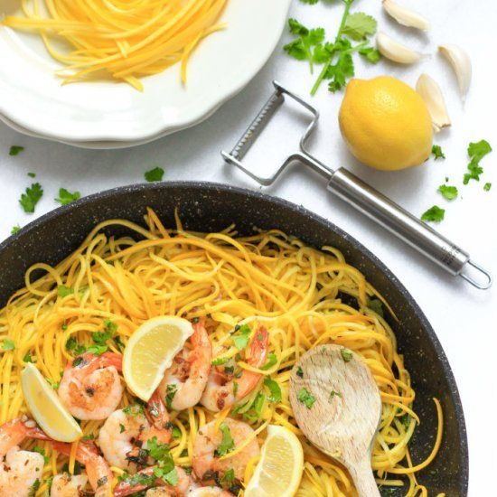 Fragrant garlic butter shrimp sautéed to golden brown perfection, on a bed of deliciously vibrant and low carb yellow squash noodles.