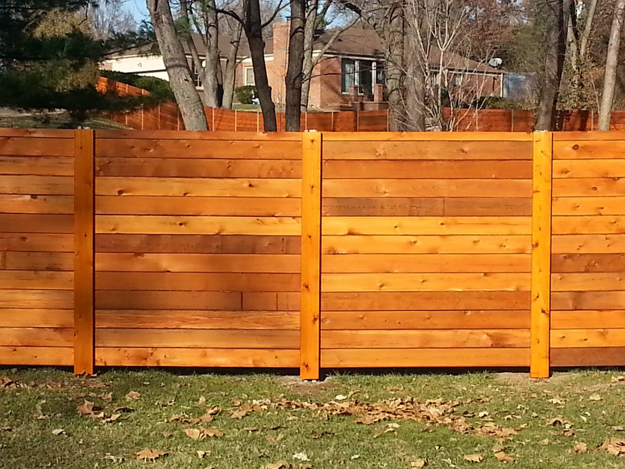This Beautiful Horizontal Western Red Cedar Fence Was Created From Deck Boards It Creates A Powerful Presence In Y Fence Design Horizontal Fence Wooden Fence