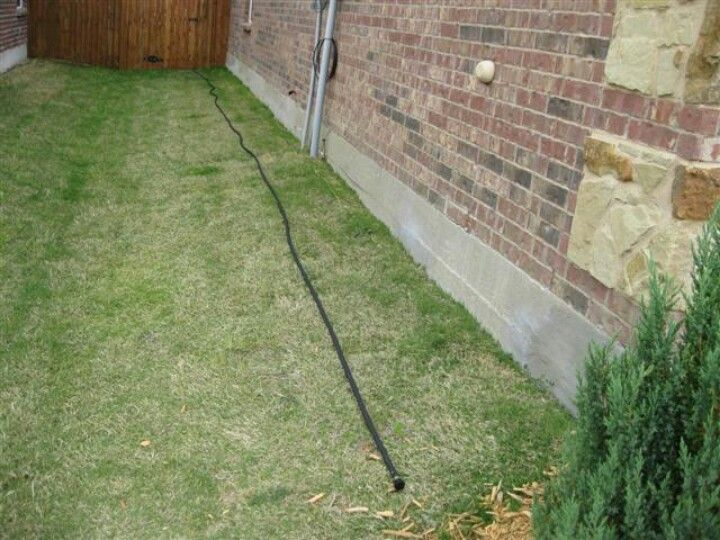 Water The Foundation With A Soaker Hose To Keep In Mind House Restoration Yard Landscaping Home Safes