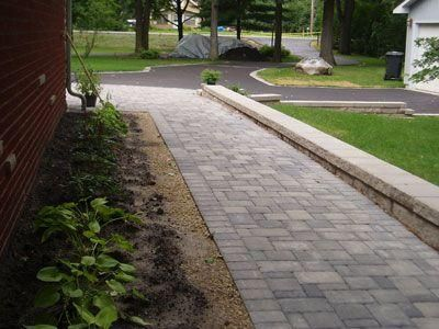 Instead Of A Fence Install Low Retaining Wall Along The