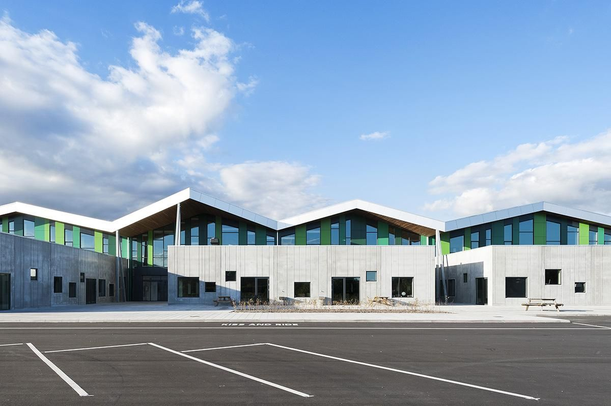 Cebra S Aabybro School Interpreted By Modern Pitched Roof And Green Strips Opened In Denmark School Building Design Roof Architecture Facade Architecture
