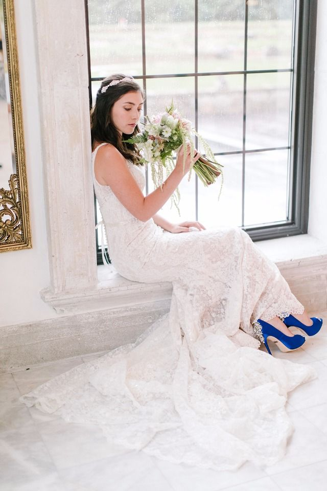 Oleg Cassini Lace Trumpet Wedding Dress with a pop of blue shoes