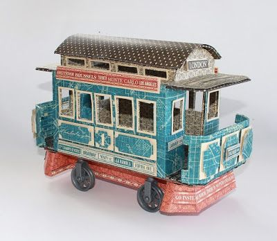 Model of the first electrical Scandinavian tram made from Graphic 45's City Scapes. Made from inspiration from Graphic 45's stand at CHA - spring 2016. The tram is made for Hobbykunst by Kirsten Hyde.