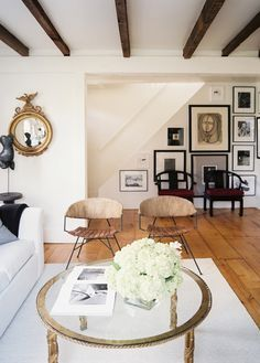 Neutral living room with gallery wall and exposed ceiling beams