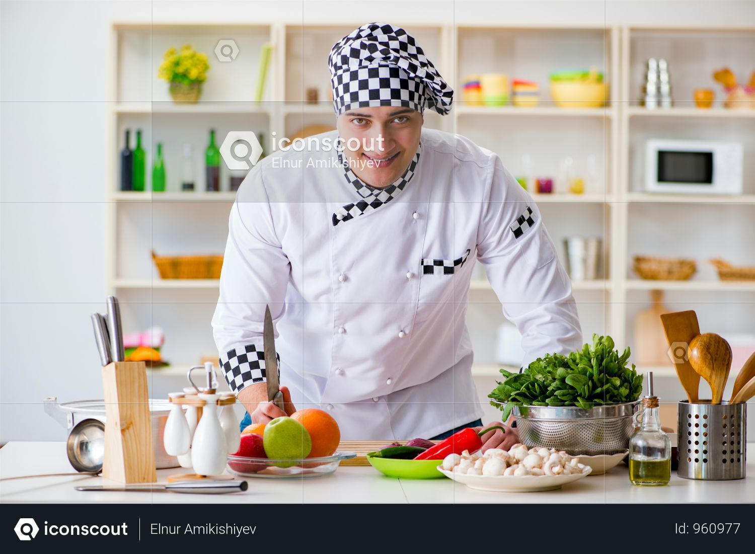 Premium Young Male Cook Working In The Kitchen Photo Download In