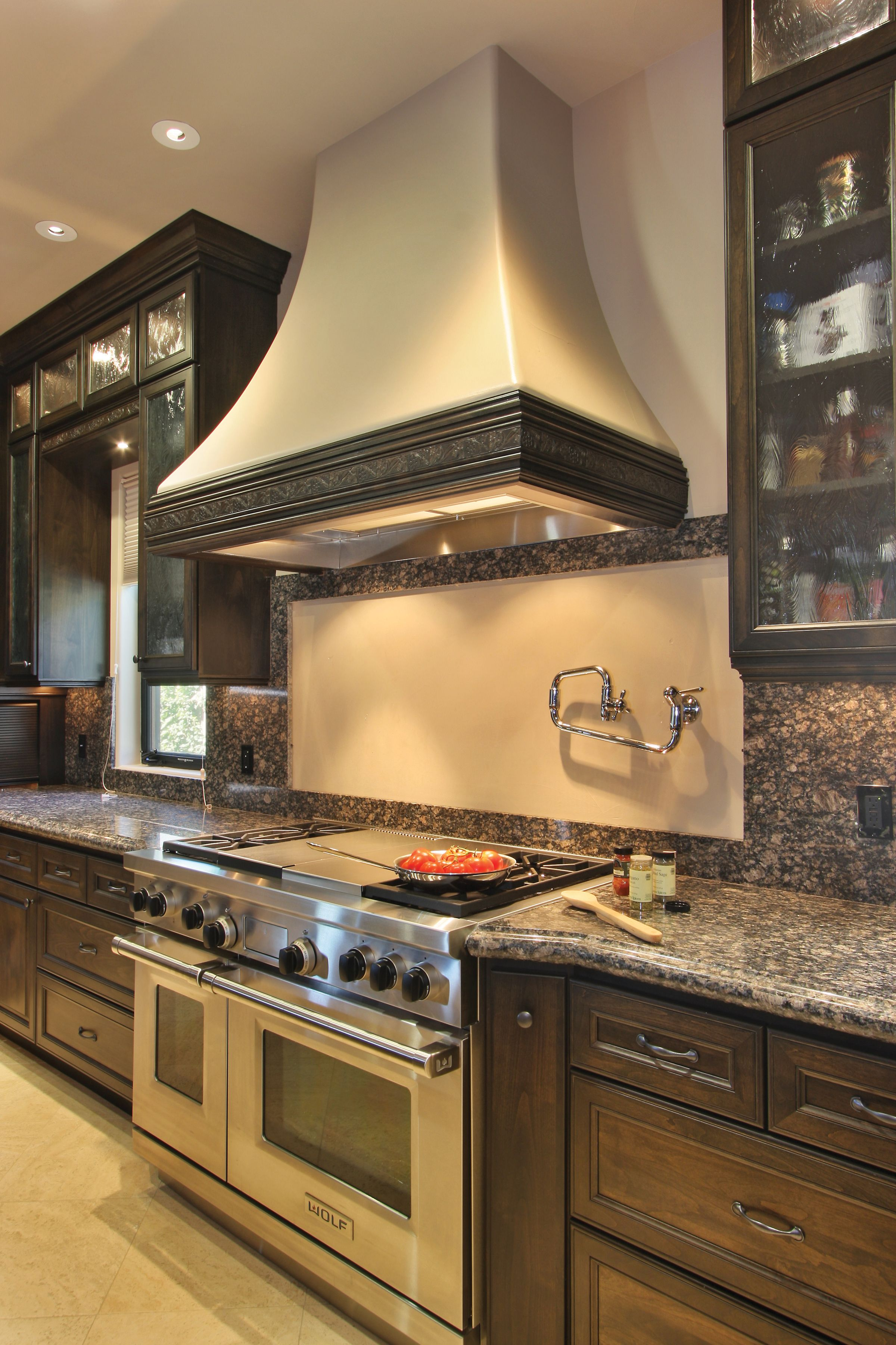 Dark stained Crystal cabinets combined with stainless steel ...