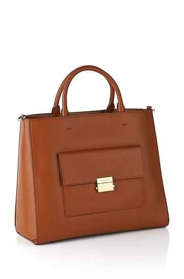 Italian-made handbag by BOSS in smooth leather with a detachable shoulder strap for women.<BR>The bag is in trendy tote style and is characterised by its linear shape.<BR>A patch pocket with a gold-coloured zip complements the design.<BR>An elegant everyday companion that is also perfect for you to use as a business bag.