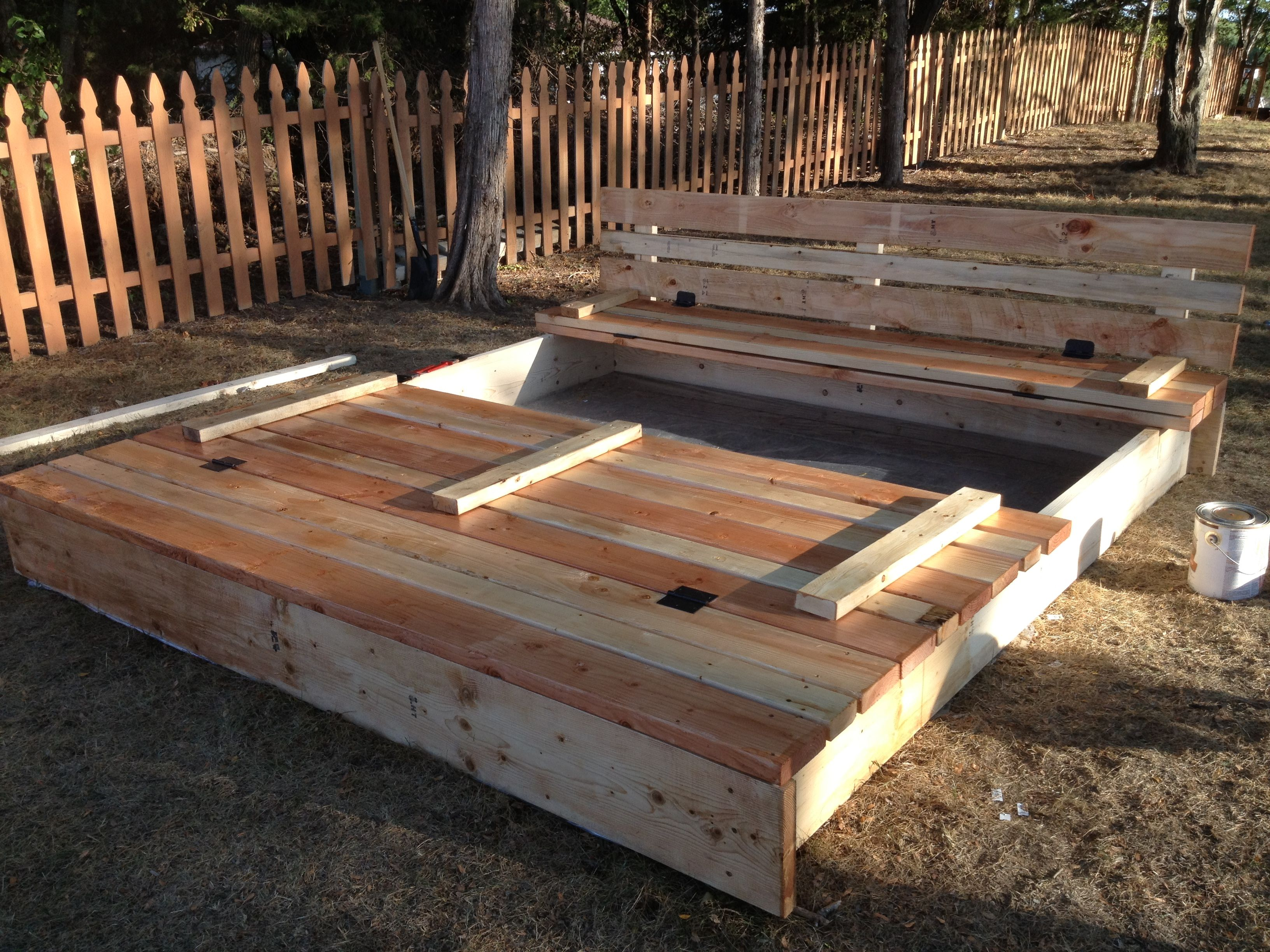 8x8 sandbox with lid that folds up to be benches on either