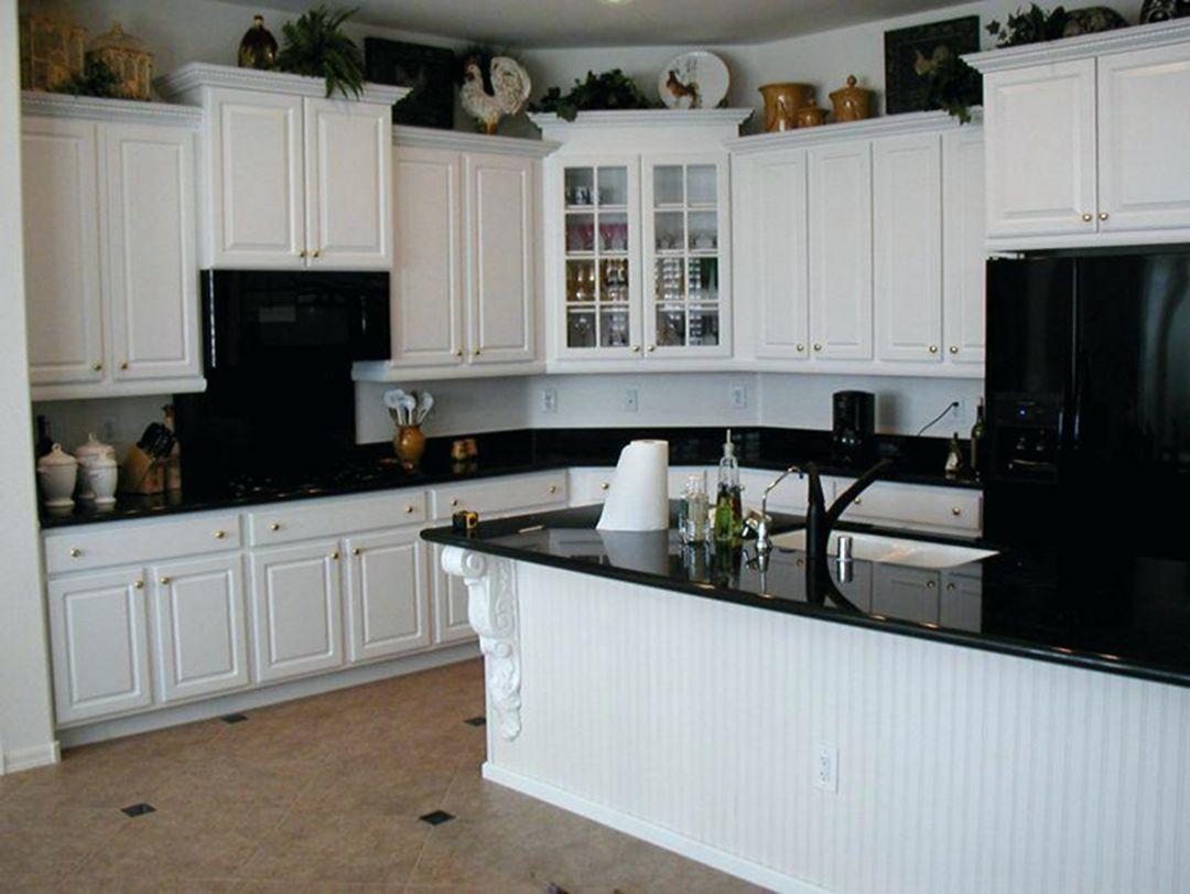 30 Elegant Black And White Kitchen Cabinet And Appliance Ideas Dexorate Antique White Kitchen Cabinets Kitchen Cabinets With Black Appliances White Cabinets Black Appliances