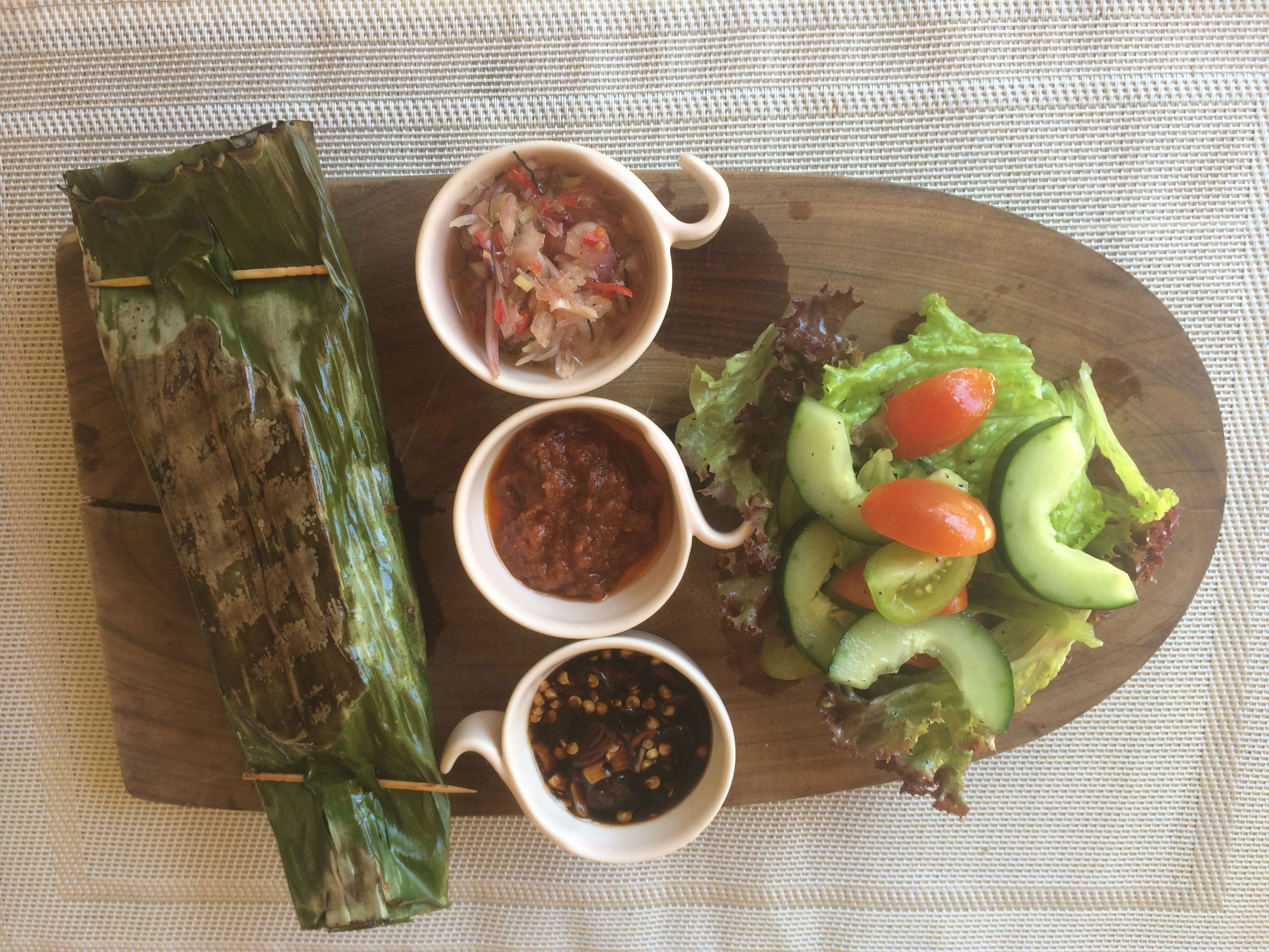 Ikan Pepes (popular Balinese dish) Staffed fish cooked in banana leaves slowly