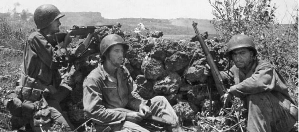 Saipan.  27th infantry division  on top of a hill over looking the canw feilds