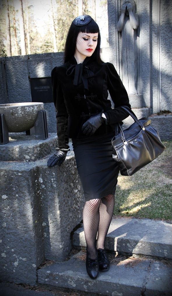 Corporate Goth is somber and sexy. Love the gloves and fascinator