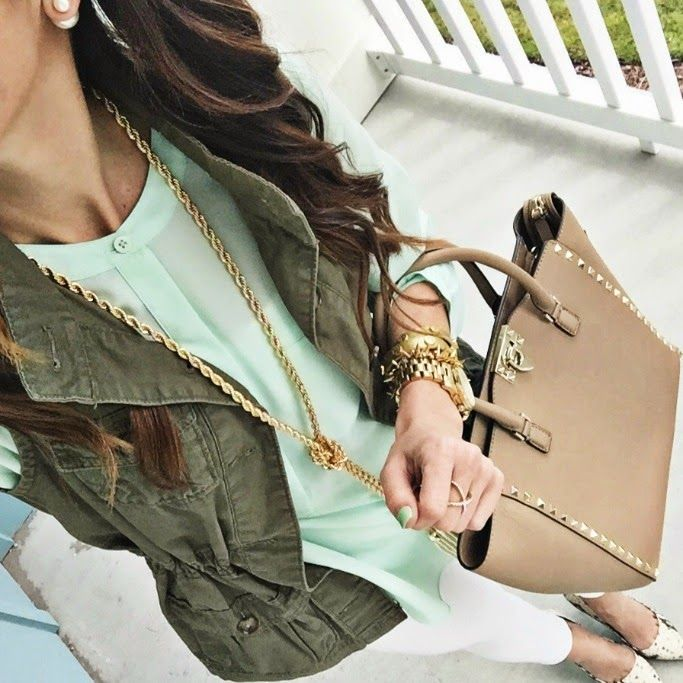 army jacket, mint top, white jeans, snakeskin shoes.