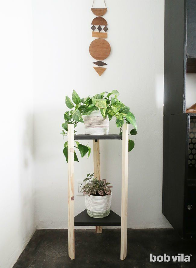 The Perfect DIY Plant Stand for Any Empty Corner is part of Diy plant stand, Corner plant, Plant stand, Diy plants, Plant stand indoor, Cool diy projects - Tis the season to celebrate your green thumb! If you enjoy afternoons tending colorful blooms, then you understand how limiting it can be to find indoor spots to display your floral favorites  Oftentimes they end up stashed in an unseen area or hiding on a windowsill behind a cafe curtain  But this weekend you can make […]
