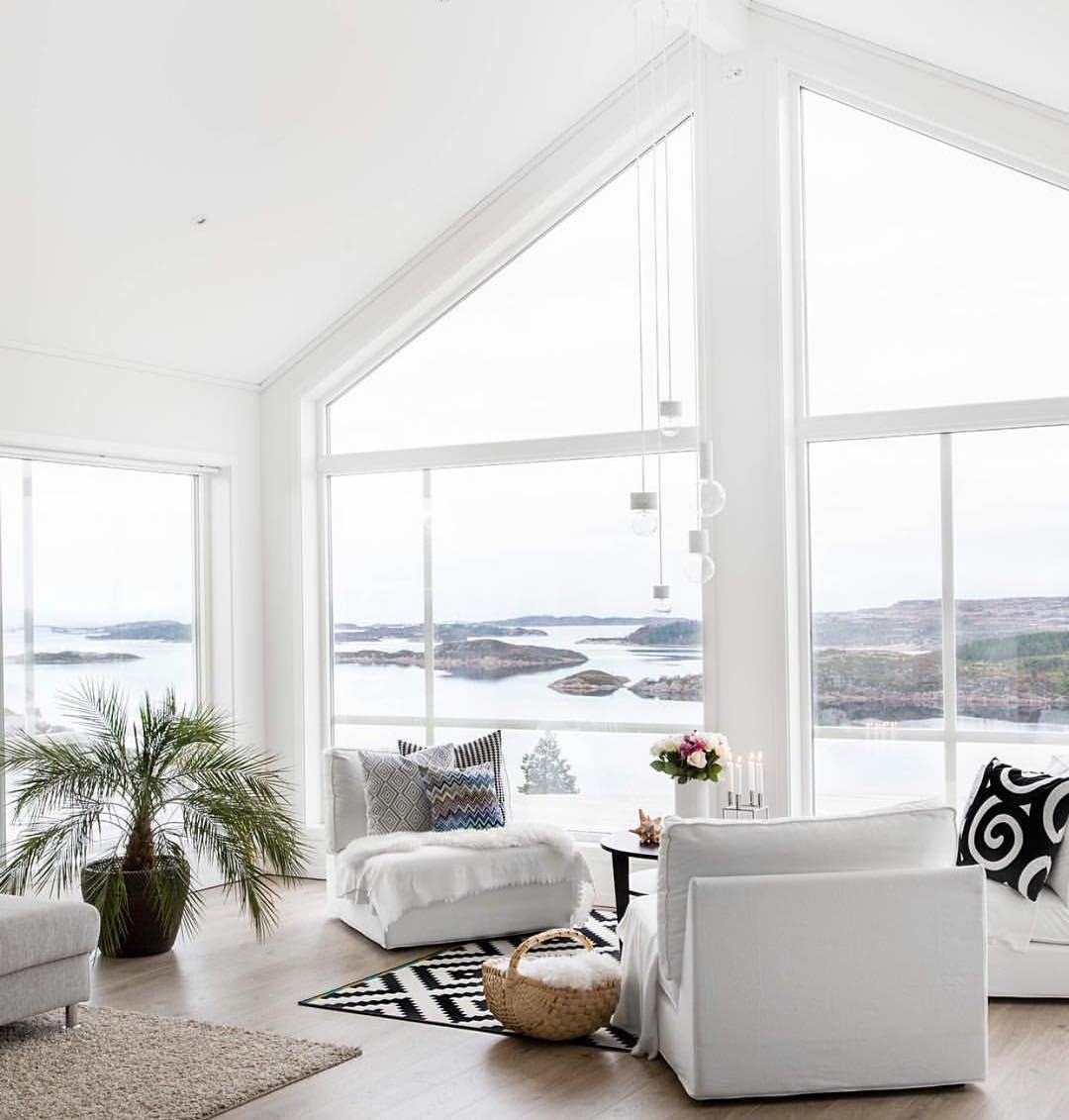 living room with a gorgeous coastal view and open windows] | Home ...