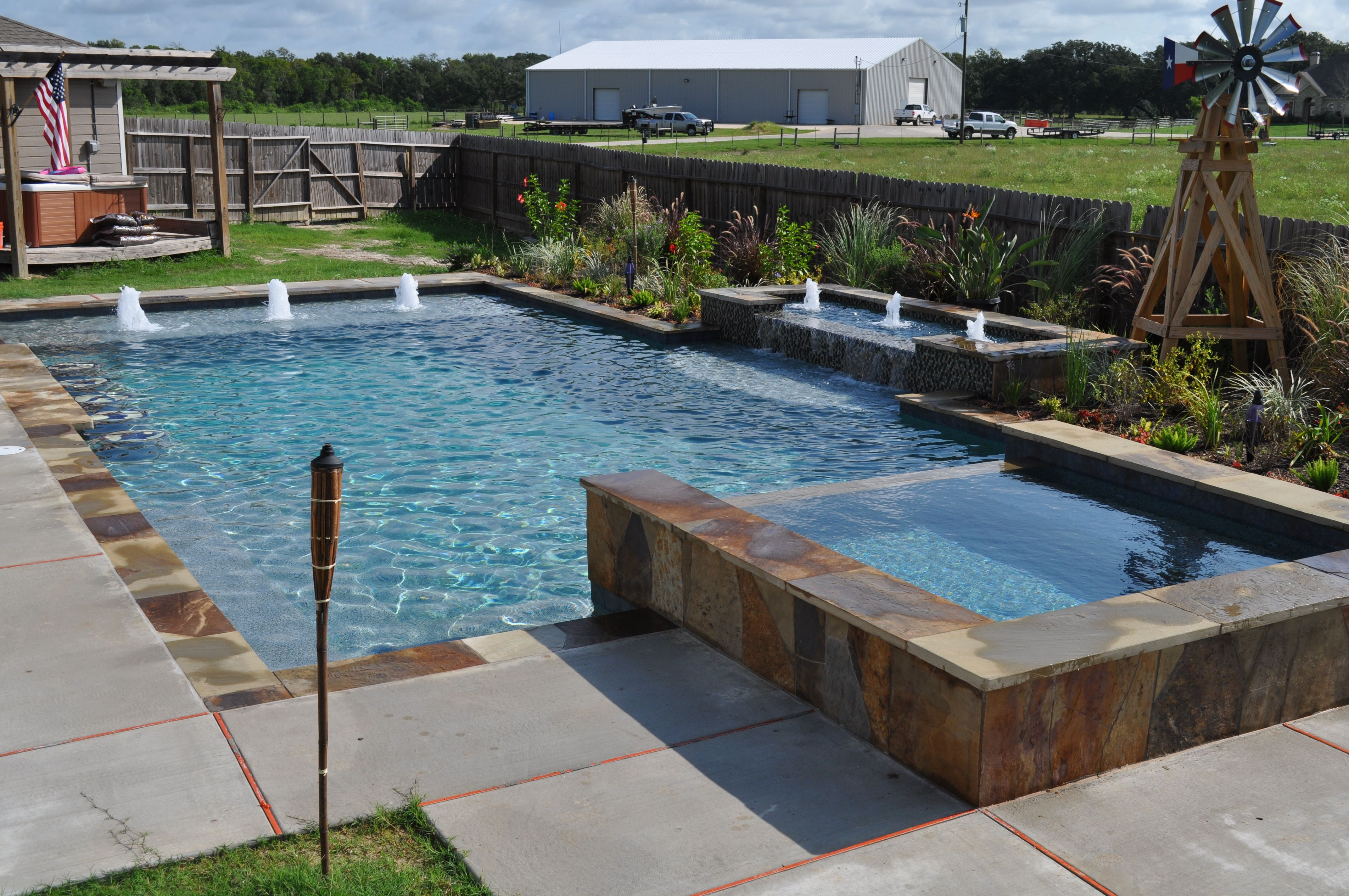 This southwest style rustic pool and spa features for Swimming pool spa designs