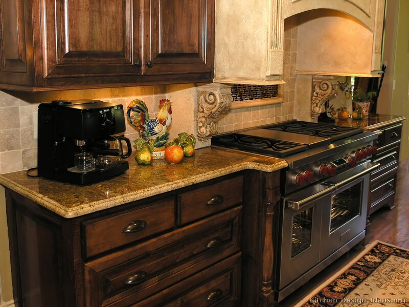 Country kitchen backsplash ideas with walnut cabinets for Dark cabinet kitchen ideas