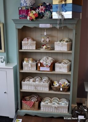 Vintage Teacups On A Shabby Chic Bookcase