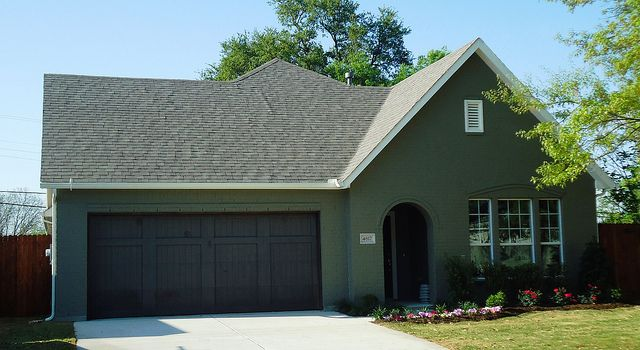 Village Homes: Dark Green Painted Brick. Bold And We Love It!