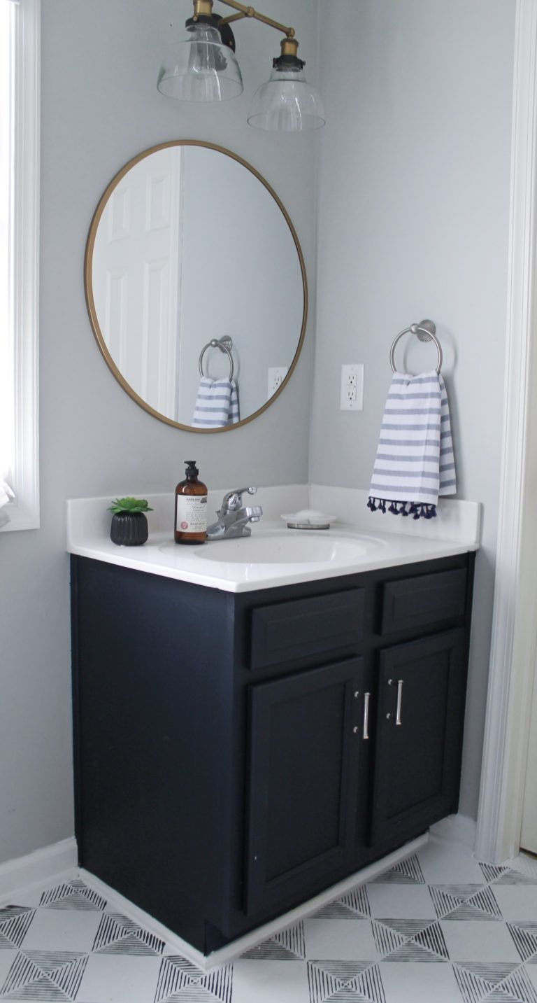 The Best $20 DIY Navy Blue & Gold Painted Vanity Bathroom Makeover