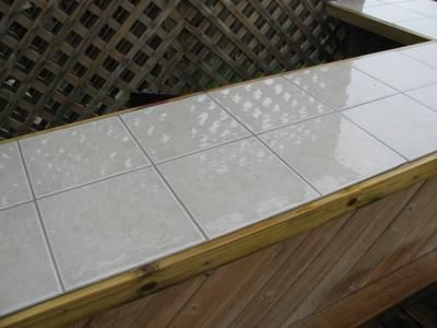 Ceramic tile outdoor kitchen countertop question i have for Tile bar top ideas