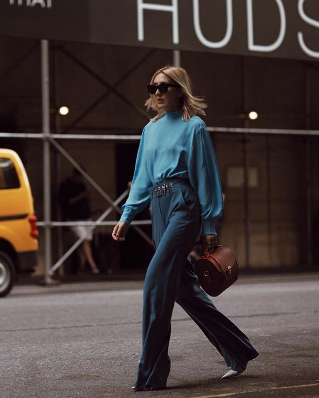 07ec62b8df17 Blogger and stylist Angela Fink wears the Marciano Wide-Leg Pant for a  street-style look at New York Fashion Week  MARCIANO