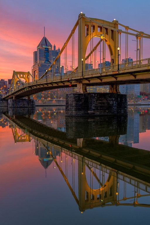 clemente crossing the clemente bridge reflected along the north shore of pittsburgh at sunrise. Black Bedroom Furniture Sets. Home Design Ideas