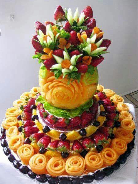 Stunning cantaloupe carving with fruit flowers