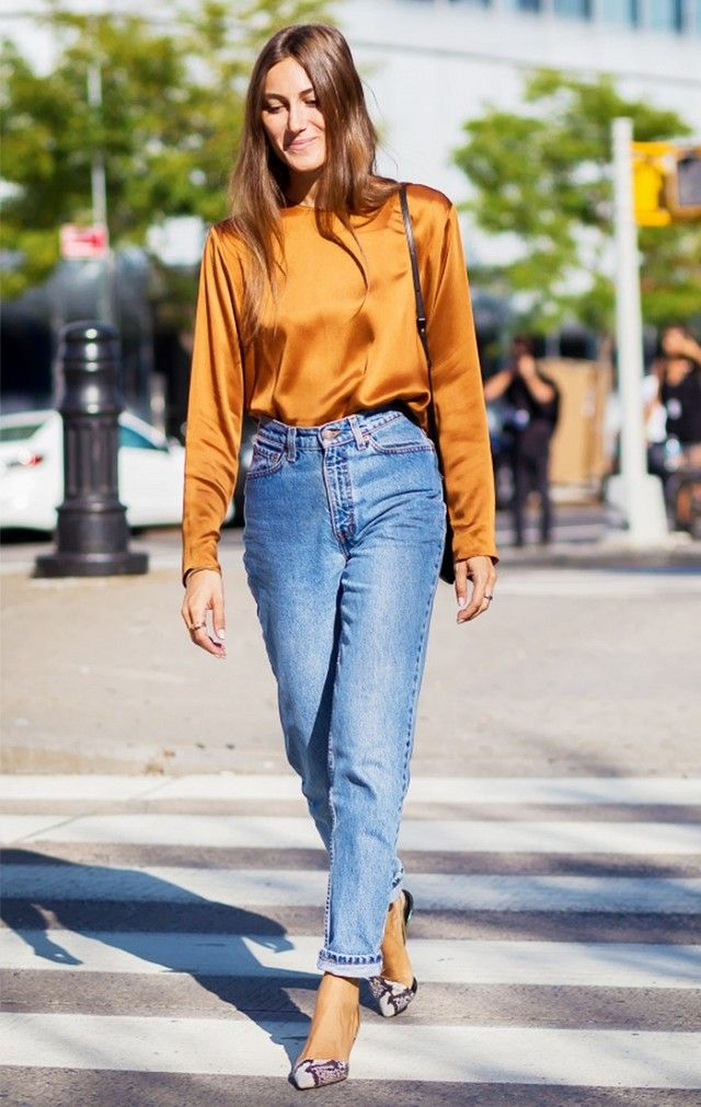 0f69473ab Giorgia Tordini wears a silk top, high-waisted jeans, and pointed-toe  python heels