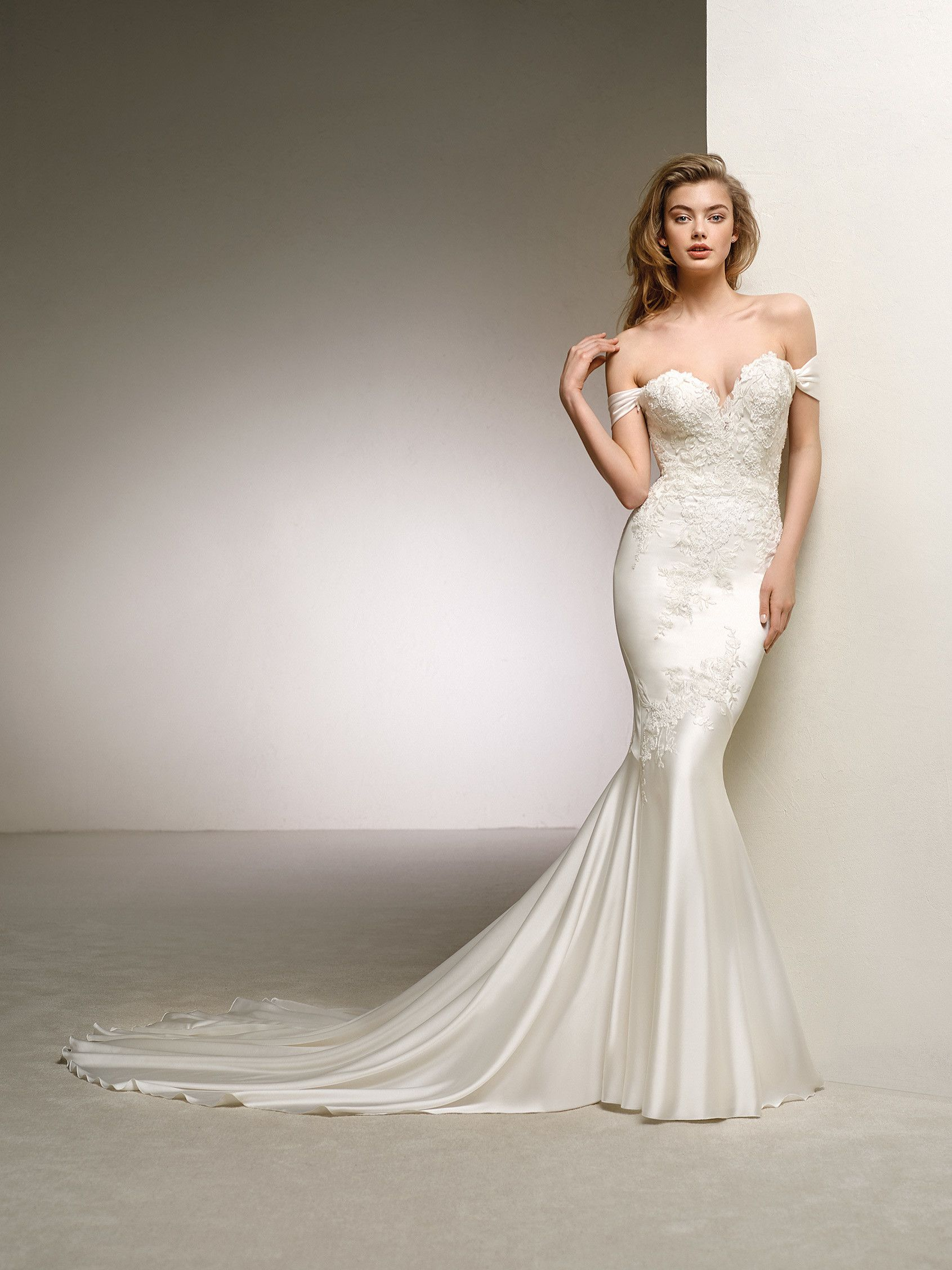 25dace897c54 Pronovias 2018 Style DANTE Glowing Silk-Satin mermaid gown with a  spectecular lace design. The sweetheart neckline contrasts with the  detachable draped ...