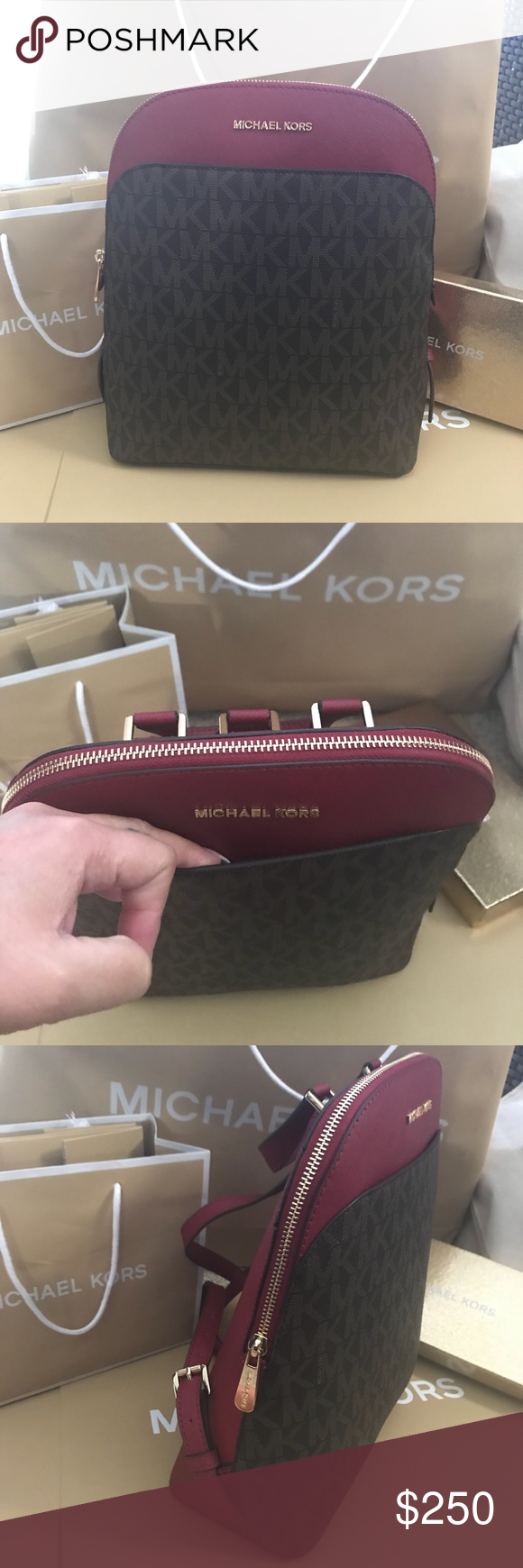 d91a7285c647 Michael Kors Emmy Backpack Brand new with tags, Emmy Backpack in Brown  monogram with Cherry and Gold emblem. Beautiful medium size backpack.