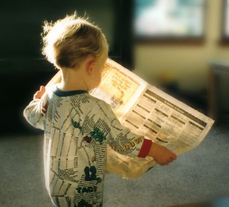 Little guy with newspaper without special effects.