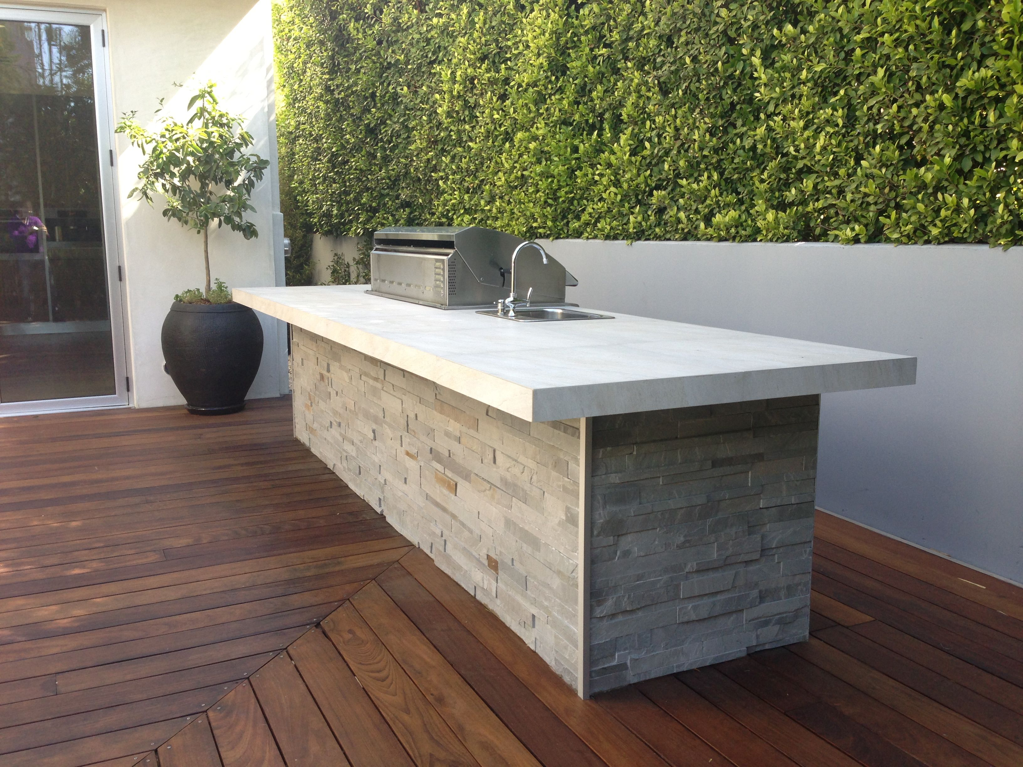 Modern bbq with tile top and ledger face outdoor kitchen bbq in