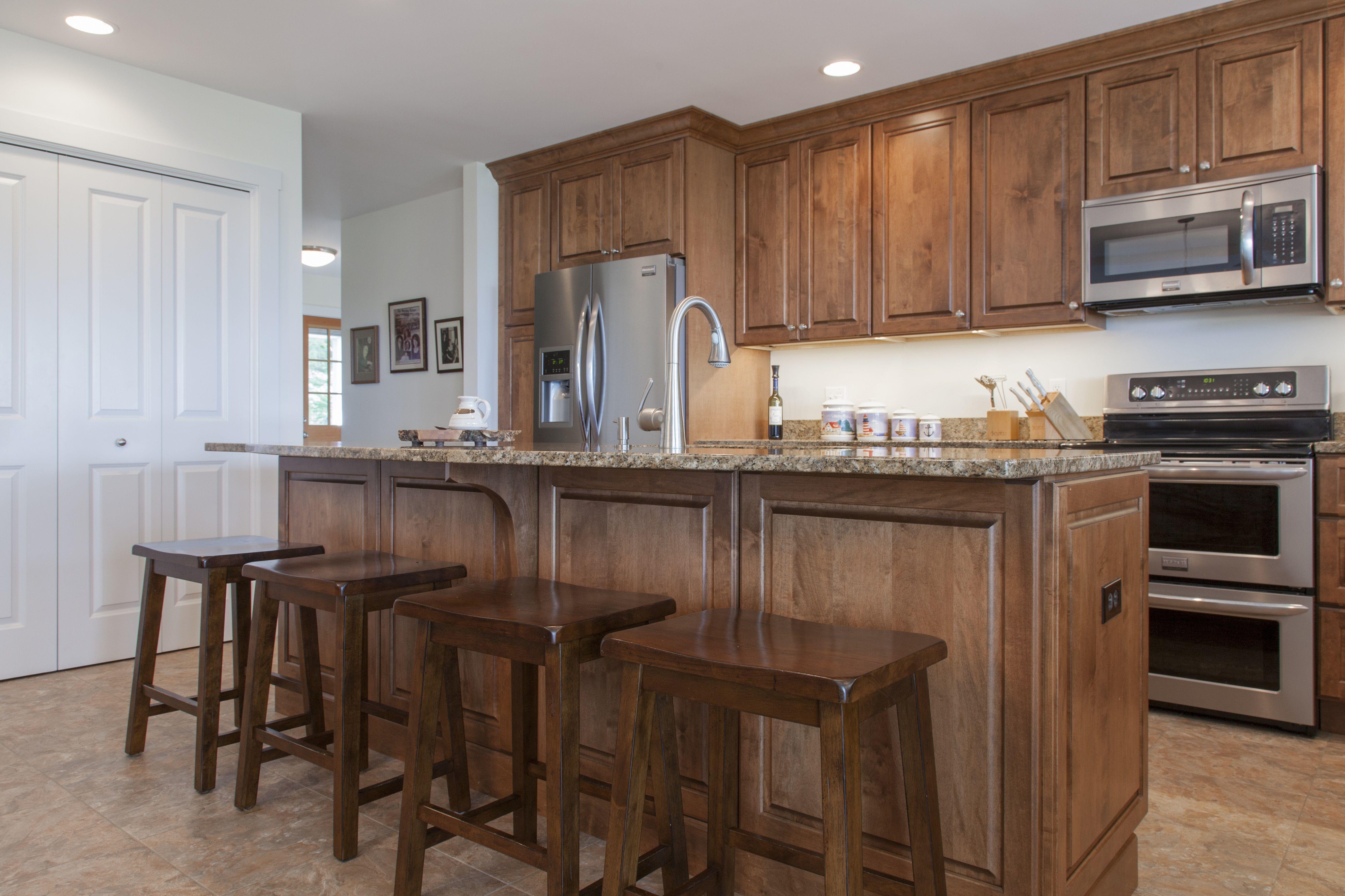 Maple raised panel door style & Giallo Veneziano granite Designed