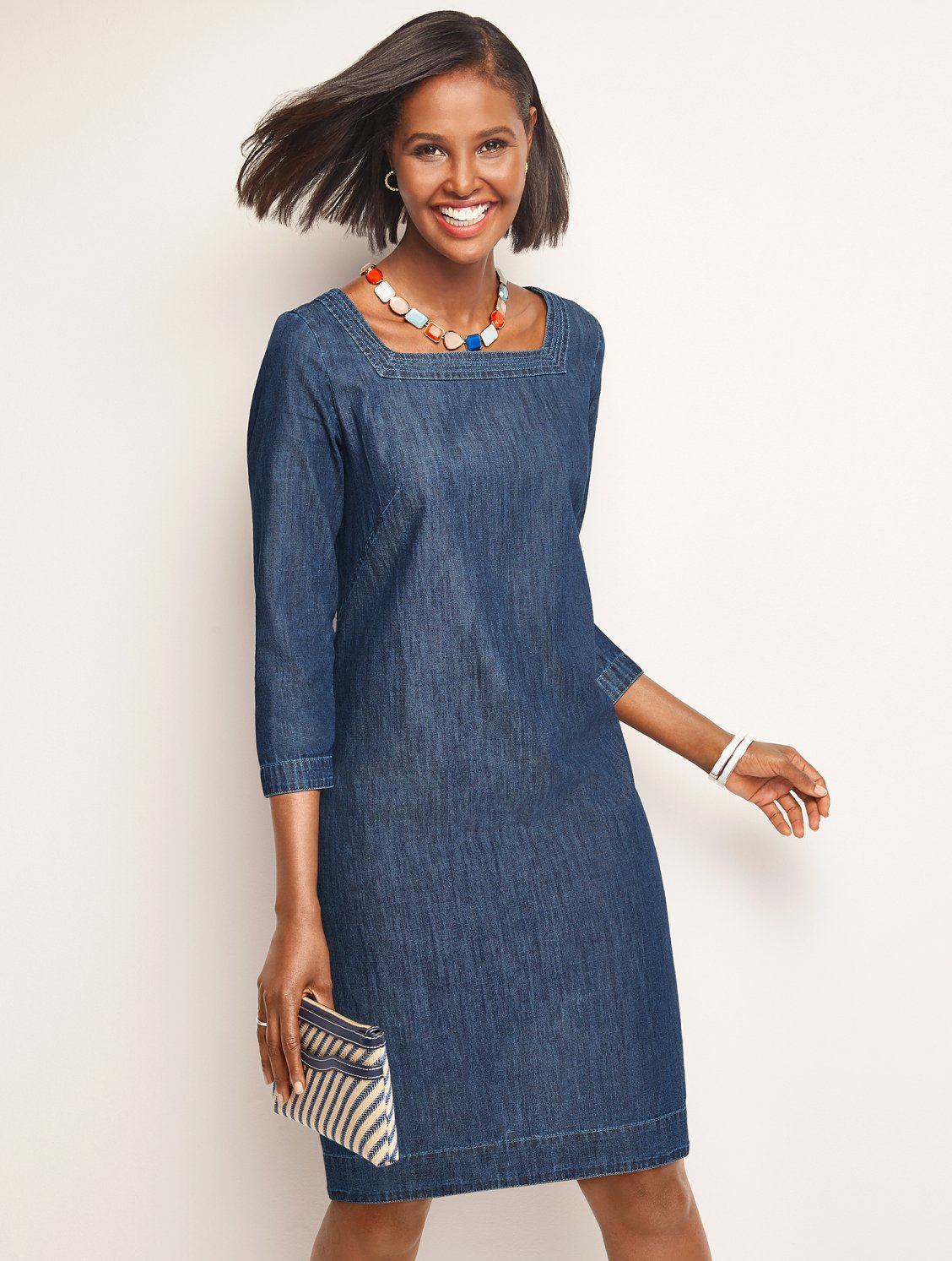 a15da2d80f5 Casual elegance at its finest. Our new denim shift features slimming  vertical lines and a
