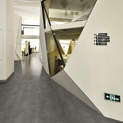 This striking modern office features Cemento polished concrete