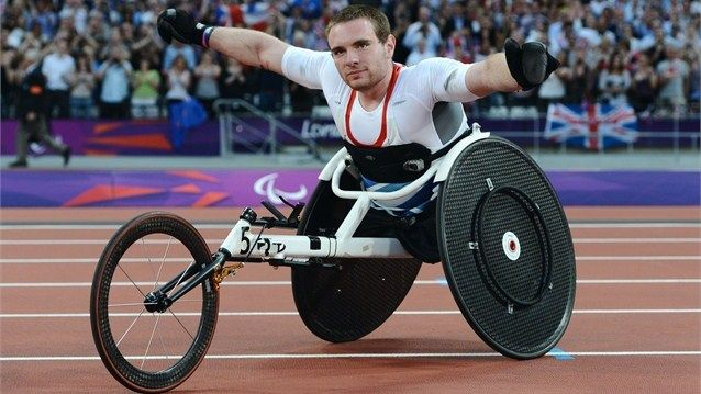 Mickey Bushell of Great Britain celebrates winning gold in the men's 100m - T53 final on Day 5