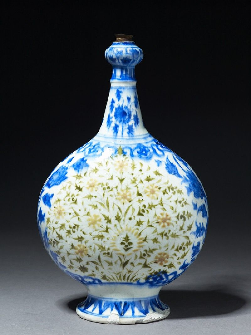 Bottle with polychrome floral decoration, Iran, Safavid Period (1501 - 1722), fritware, with underglaze painting in coloured slips and blue, 35 x 21 x 11 cm max. (height x width x depth), at foot 12 cm (diameter). Gift of Gerald Reitlinger, 1978. (EA1978.1709). Ashmolean Museum © Ashmolean Museum, University of Oxford