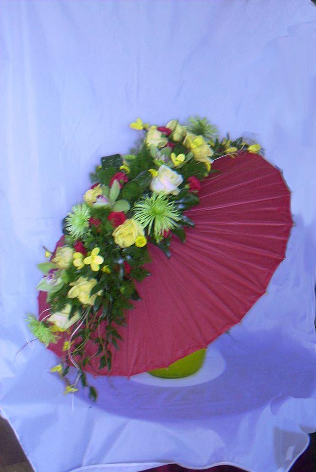 Umbrella arrangement anyone? Cascading flowers down a paper shade umbrella. ©Naples Flowers