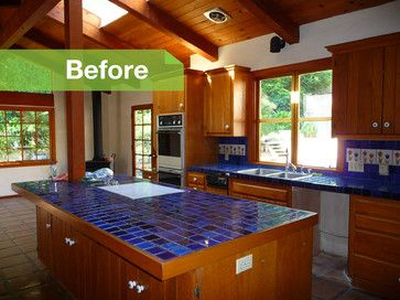 BEFORE: Stone countertops and hickory cabinets replaced this worn-out-looking blue tile. The designer also replaced all the wood-frame windows in the house with metal ones to cut down on maintenance and obstruction of views.