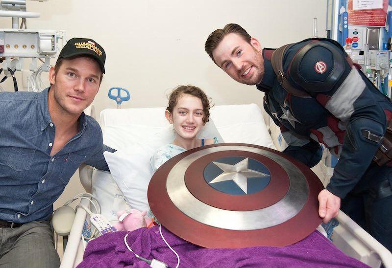 Hollywood superheroes Chris Evans, who plays the role of Marvel's Captain America, and his friend Chris Pratt (who plays Star-Lord in the film Guardians of the Galaxy) made good on a friendly Super Bowl bet on Saturday visiting Seattle Children's Hospital bringing gifts and joy to young patients