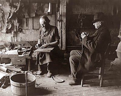 an old cobbler in his shoemaking shop, 1903