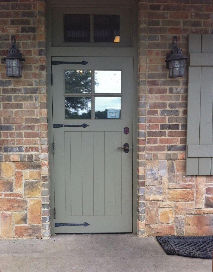 Front door with black ironmongery. This door has been hung with butt ...