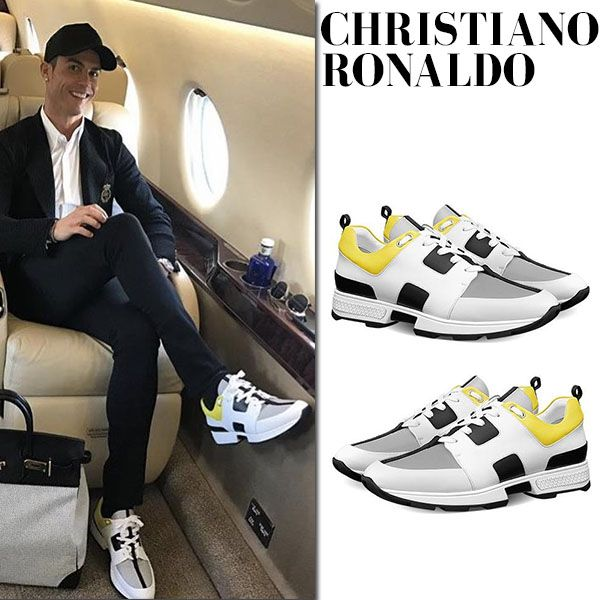 Christiano Ronaldo in white and yellow Hermes sneakers