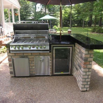 Beautiful This L Shaped Outdoor Kitchen Features A Bar Counter Sitting Area. Besides  The Grill