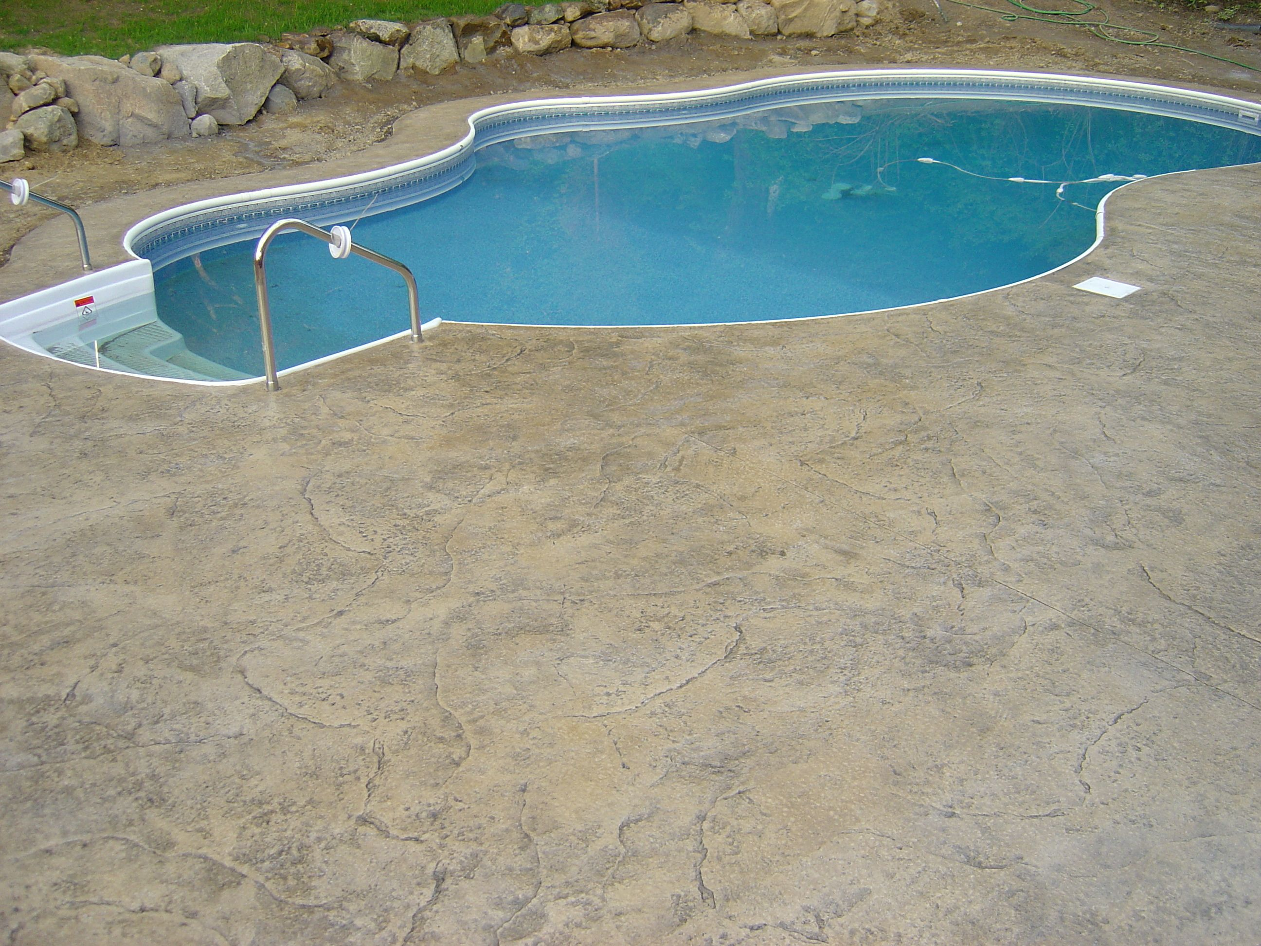 Stamped concrete pool deck. Seamless stone pattern in a