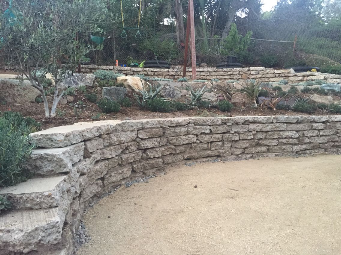Curved Stacked Recycled Concrete Urbanite Retaining Walls Landscaping Retaining Walls Recycled Concrete Retaining Wall
