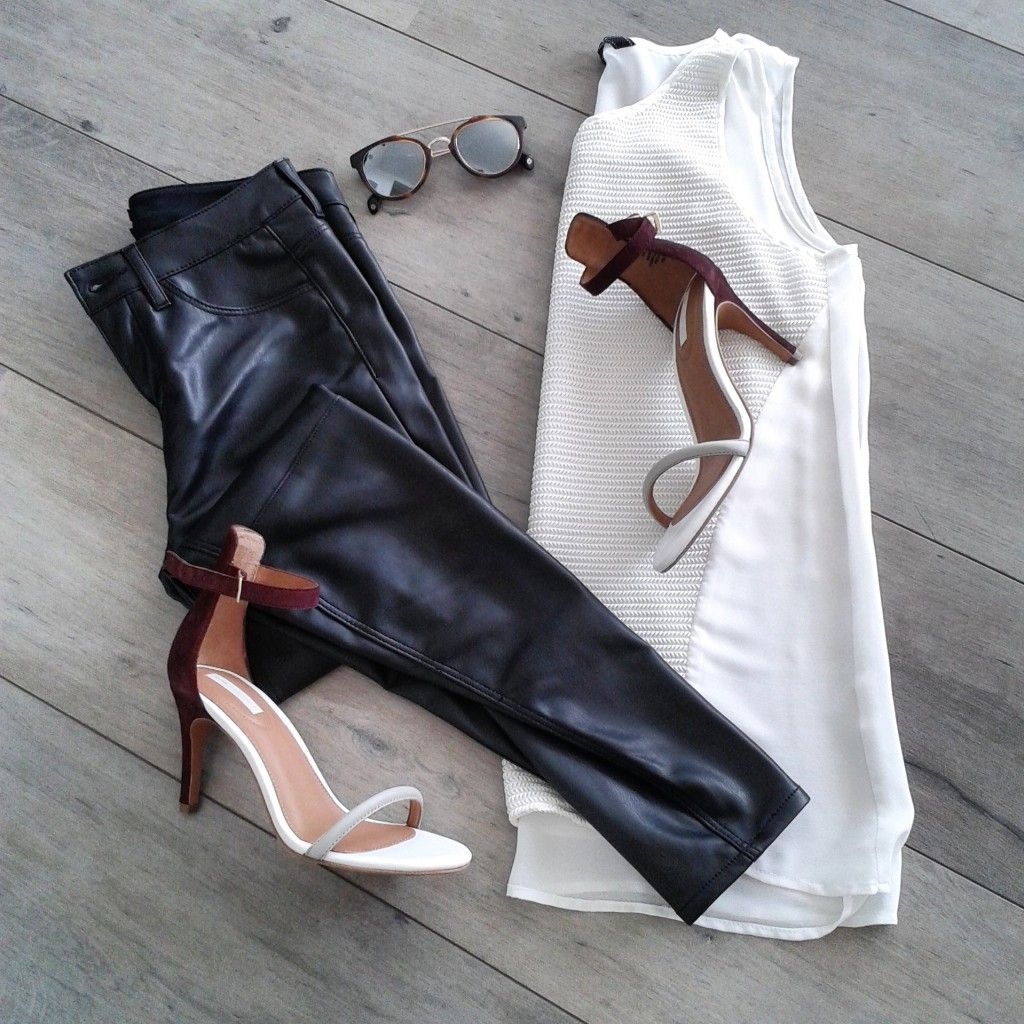 An elegant look with faux leather pants