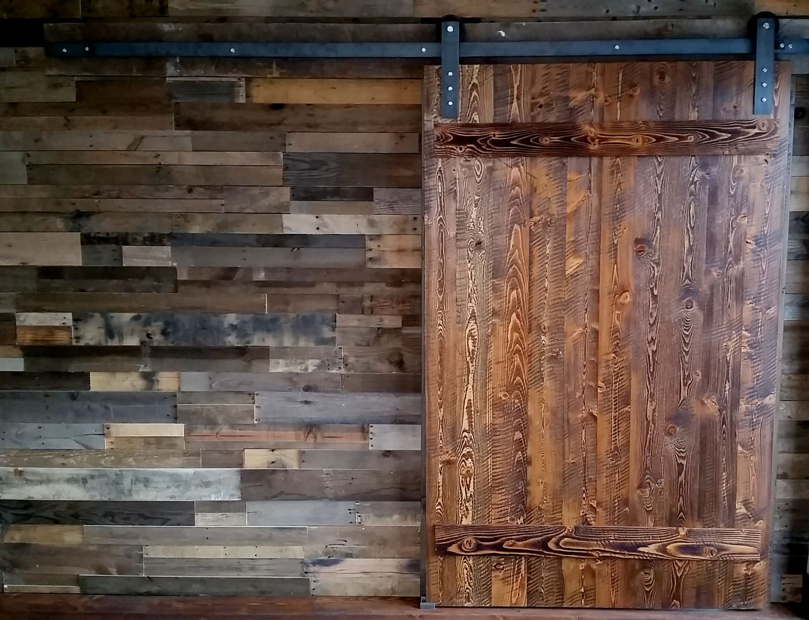 Custom barn doors available per order pictured here in a for Reclaimed pallet wood wall
